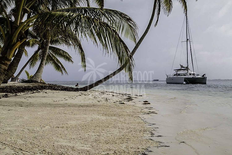 yacht-anchored-near-beach